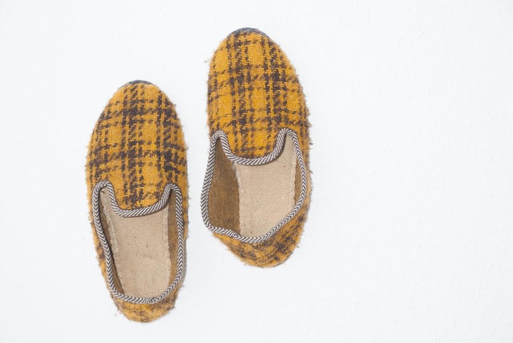 pair of yellow-and-black plaid slip-on shoes