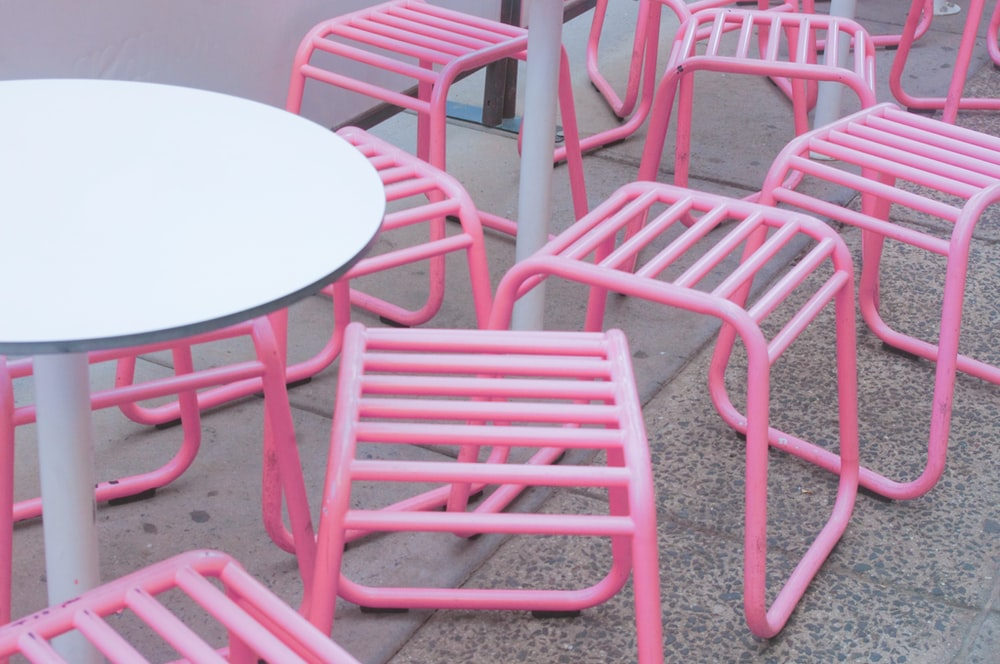 round white pedestal table and pink chairs