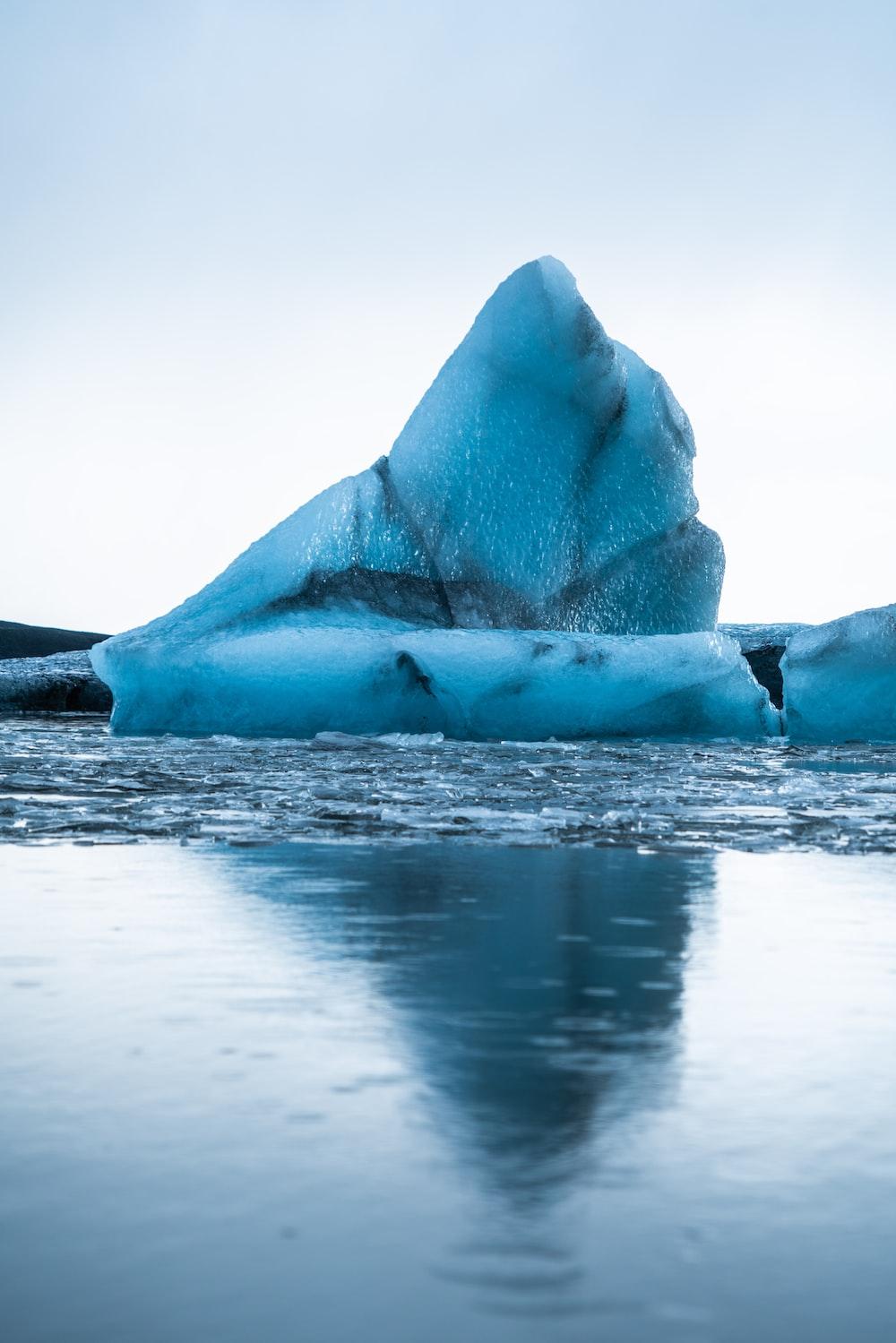 glacier on sea during daytime