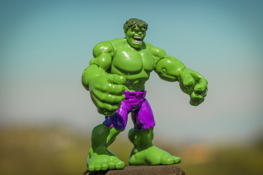 Marvel Hulk action figure standing on gray surface
