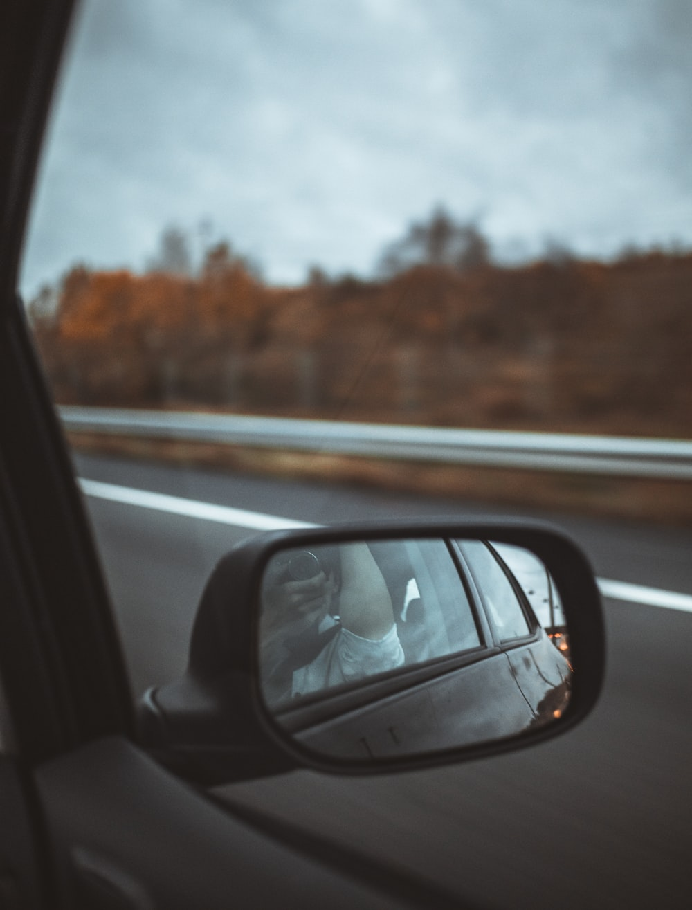 person showing black side mirror