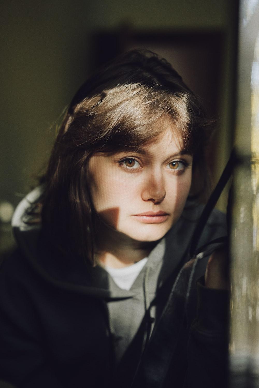 woman near brown wall