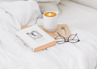 coffee in ceramic mug served on board