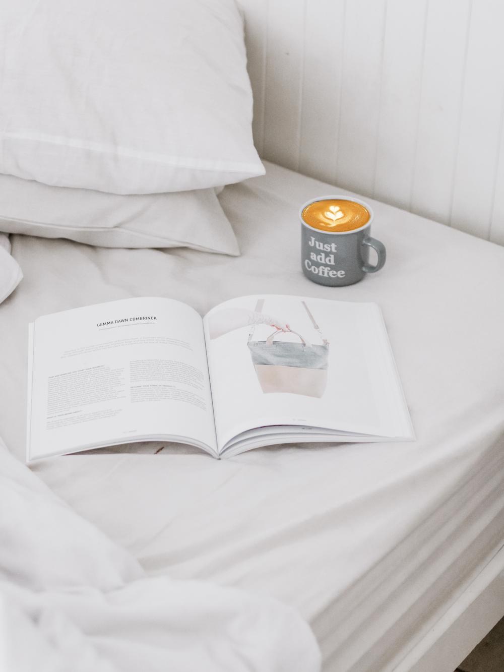 ceramic mug beside opened book