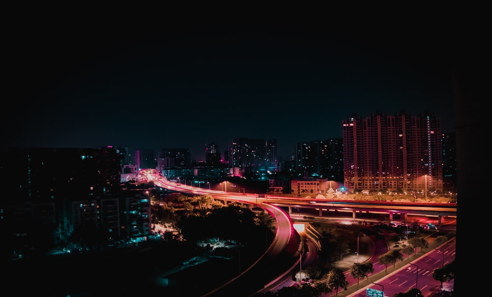 timelapse photography of vehicle and city during nighttime