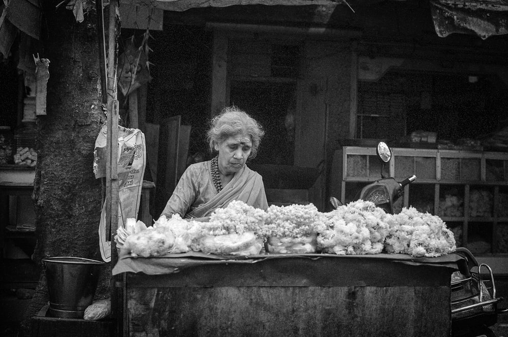 woman looking at vegetables