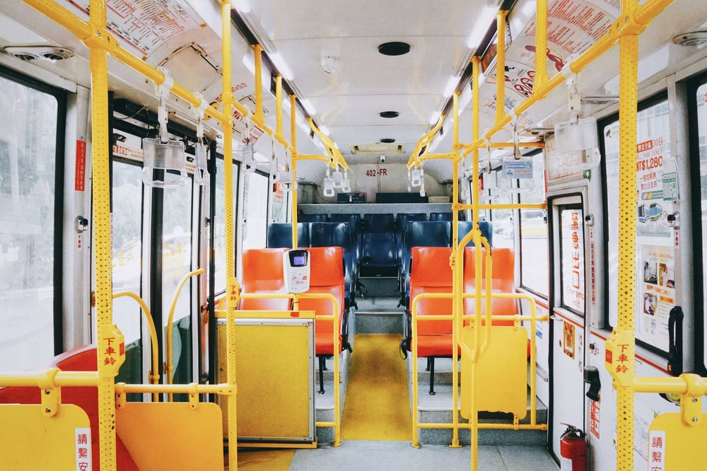 empty white and yellow bus