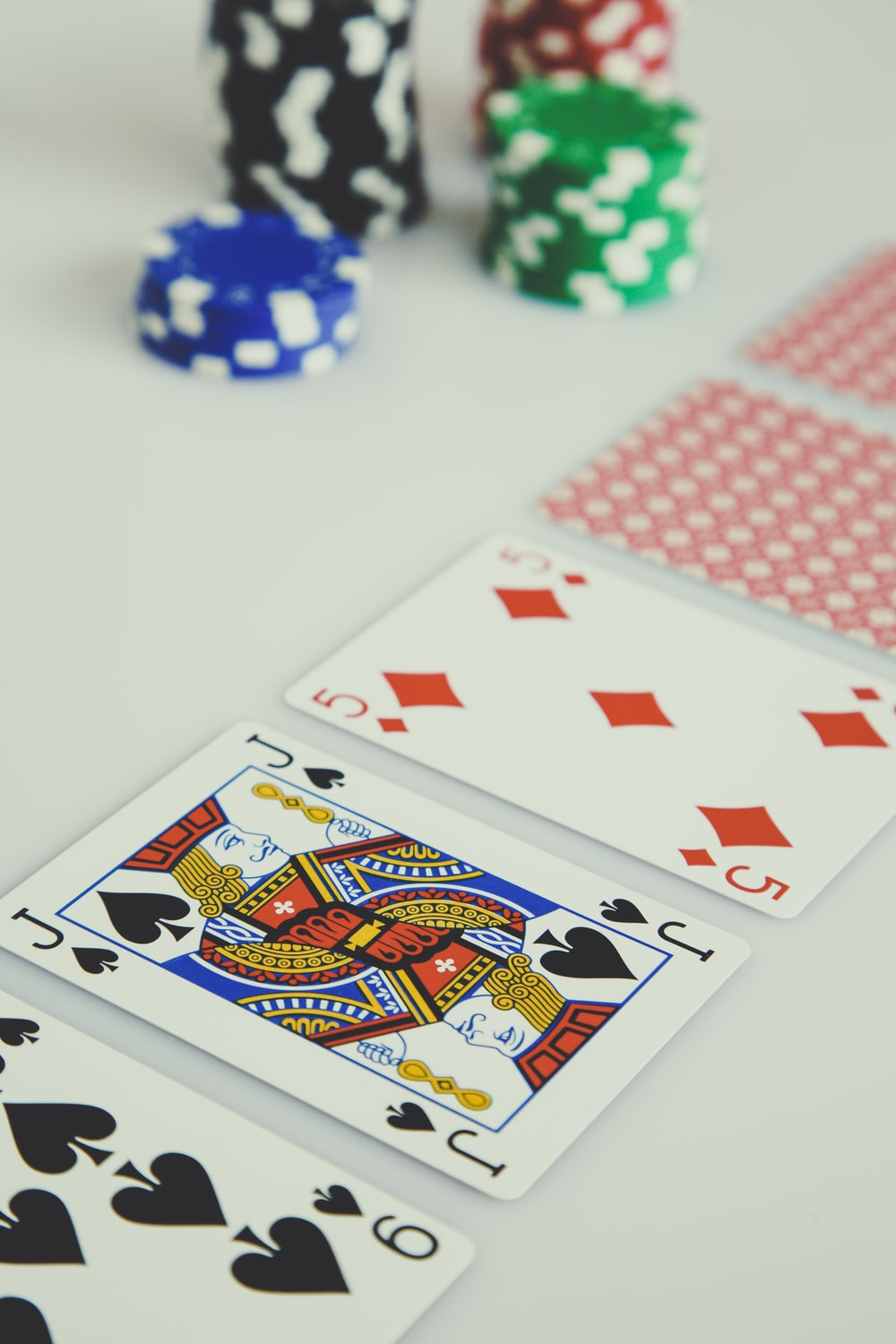assorted playing cards on white surface