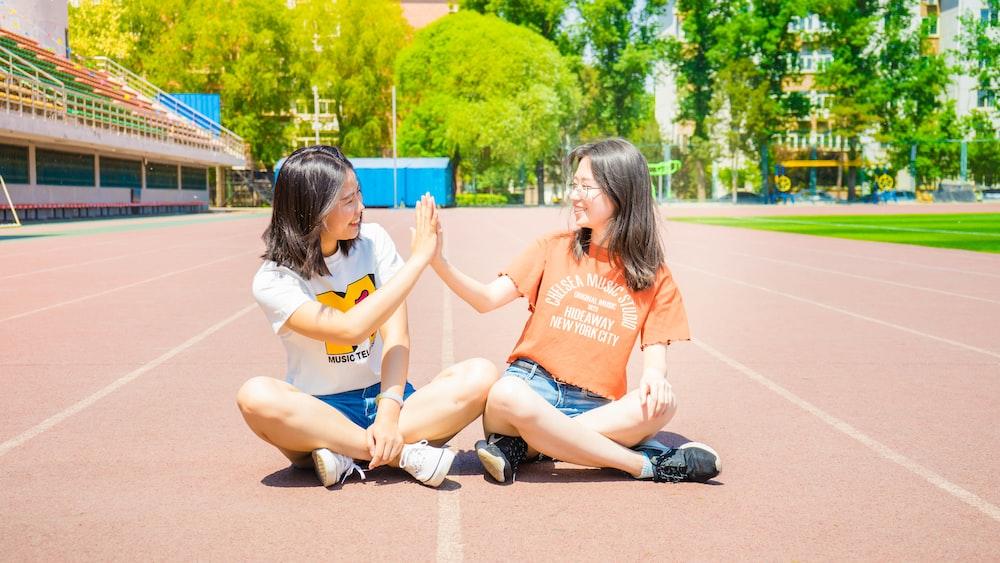 two women doing high five