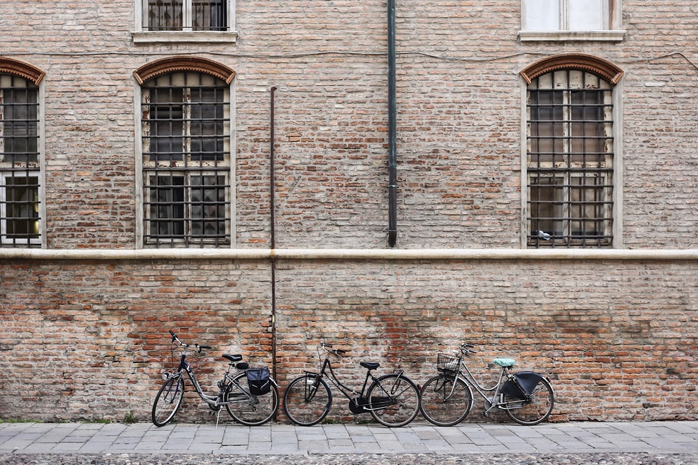 three parked bicycles