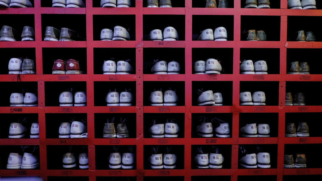 Bowling shoes all stacked and organised.