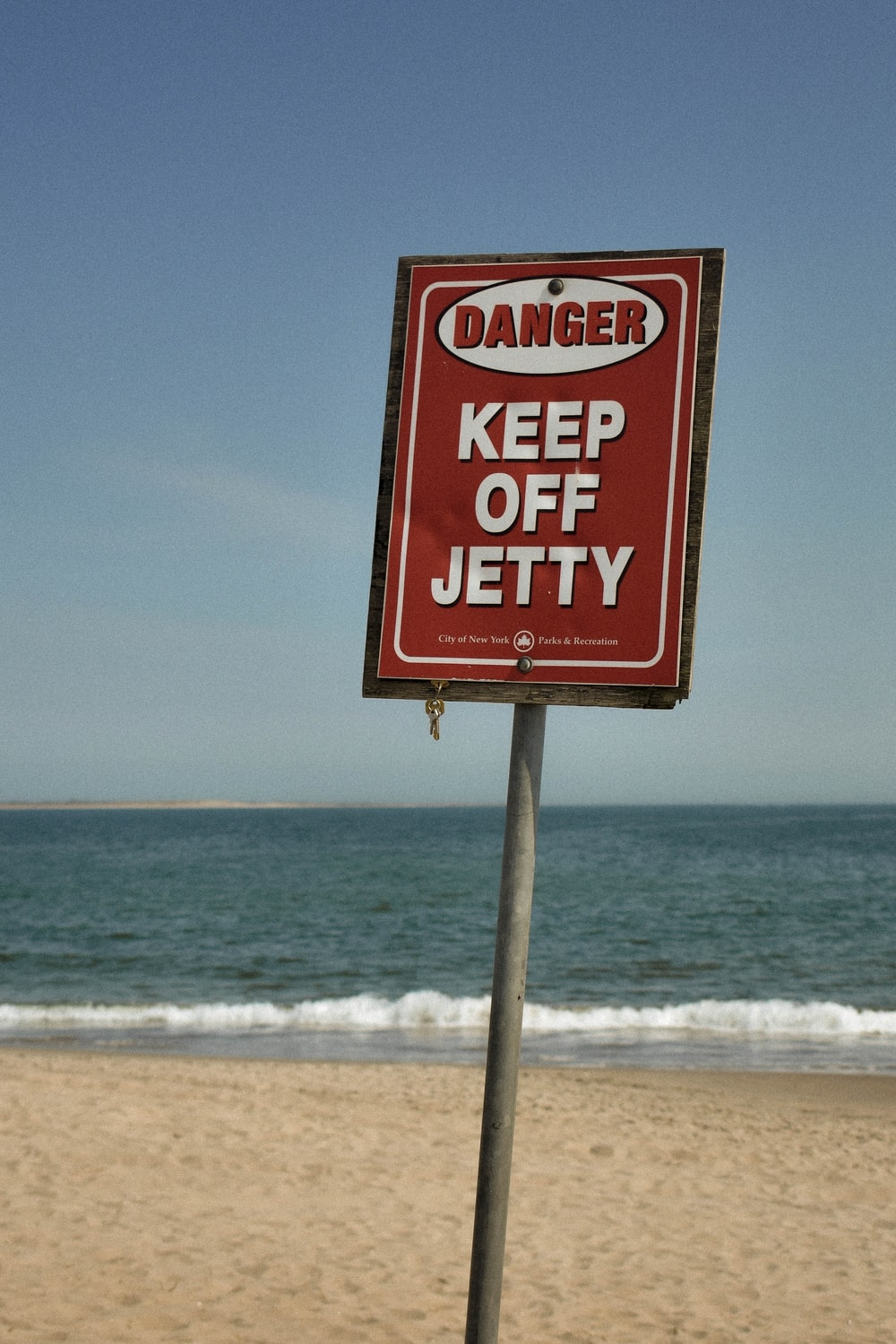 danger keep off jetty sign