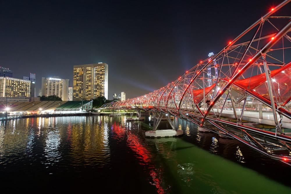 red metal bridge at night