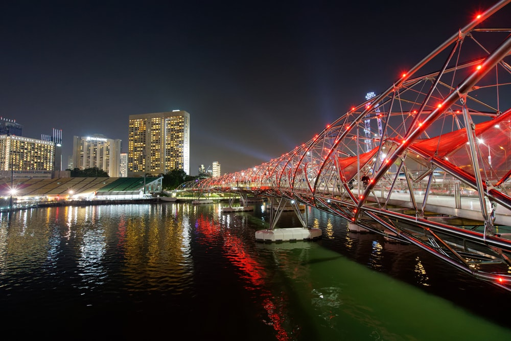 red metal bridge at night