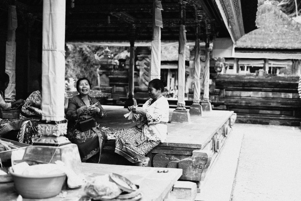 two woman sitting on porch