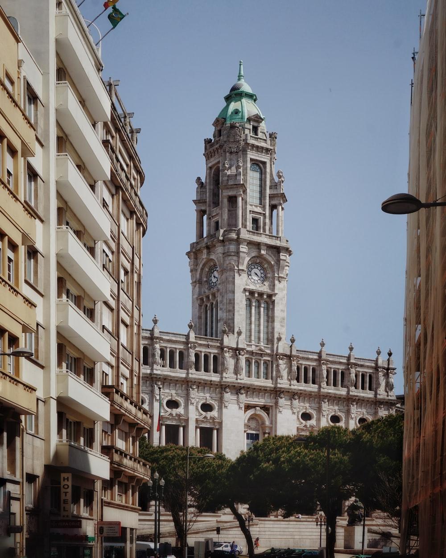 white concrete clock tower