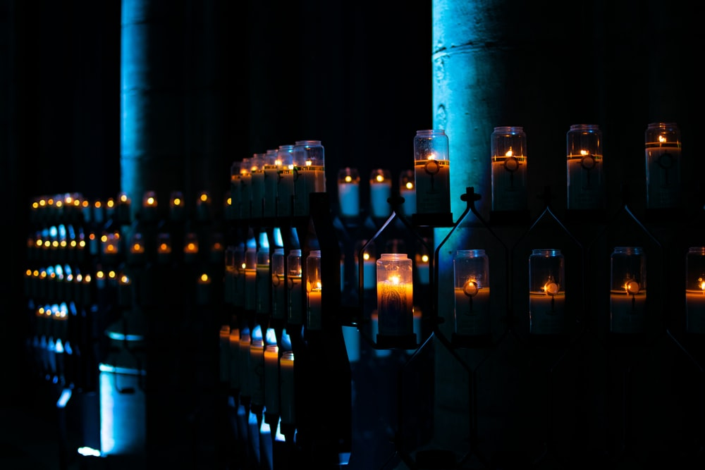lighted candles on shelves