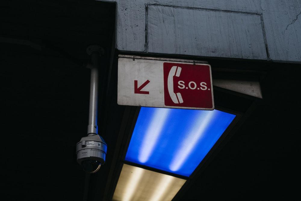 SOS signage near dome security camera