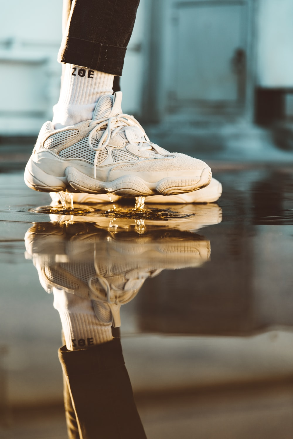person wearing white basketball shoes