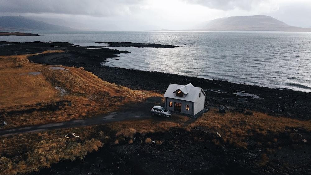 white house near shore