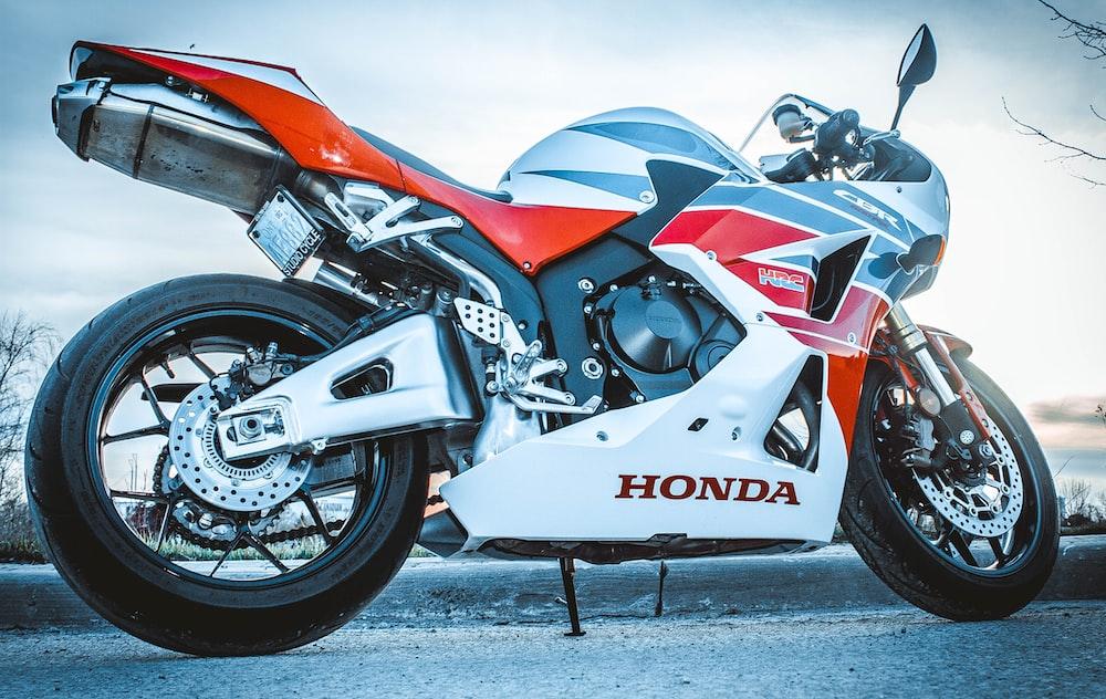 white and orange Honda sportbike