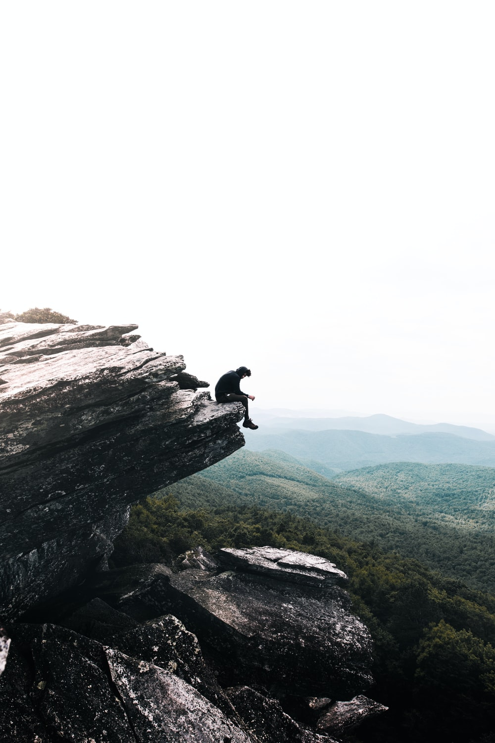 person sitting on rock formations