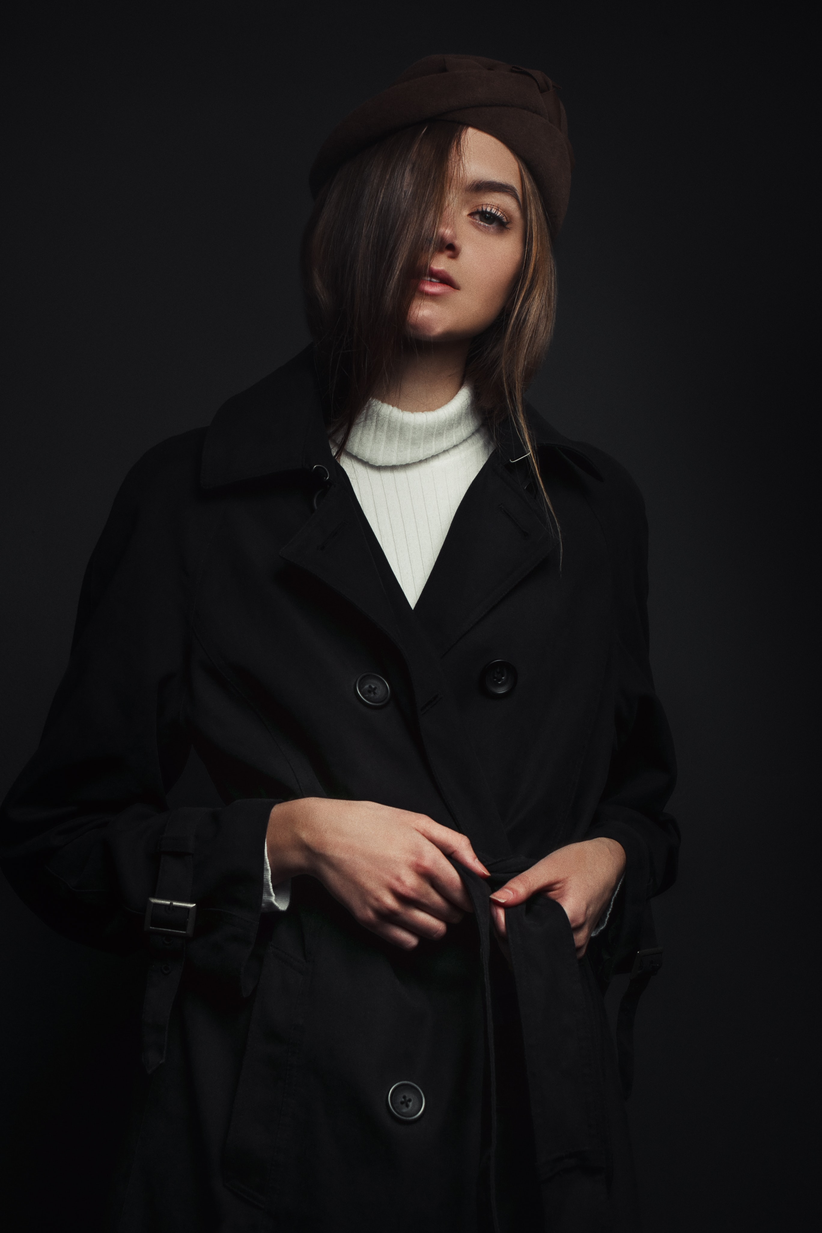 woman wearing black double breasted coat