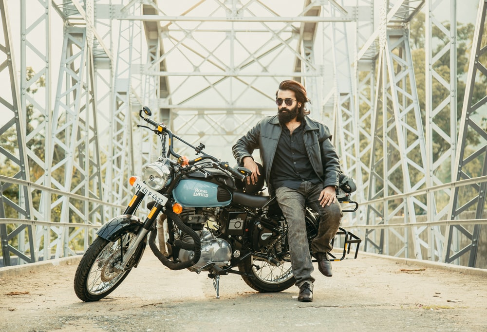 man and a motorbike on a bridge