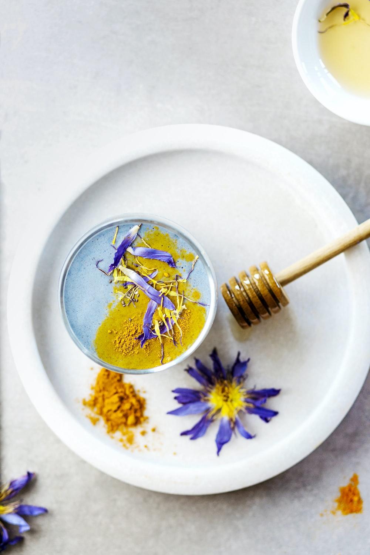 honey dipper on white ceramic plate