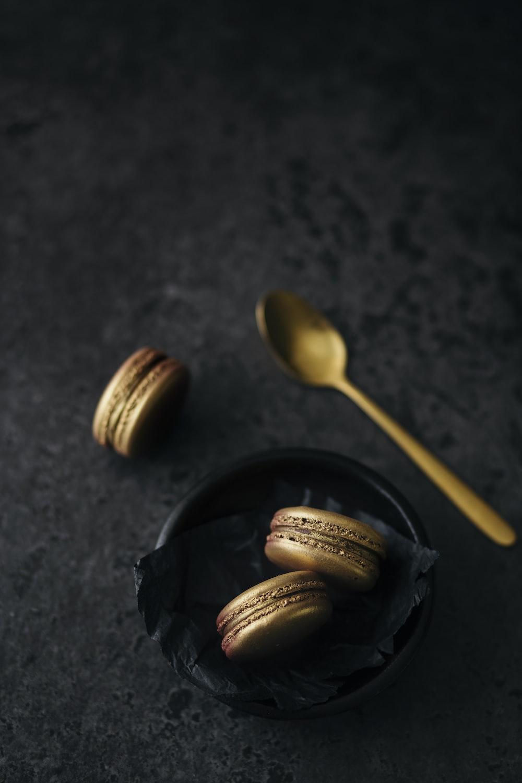 three macaroons on black bowl