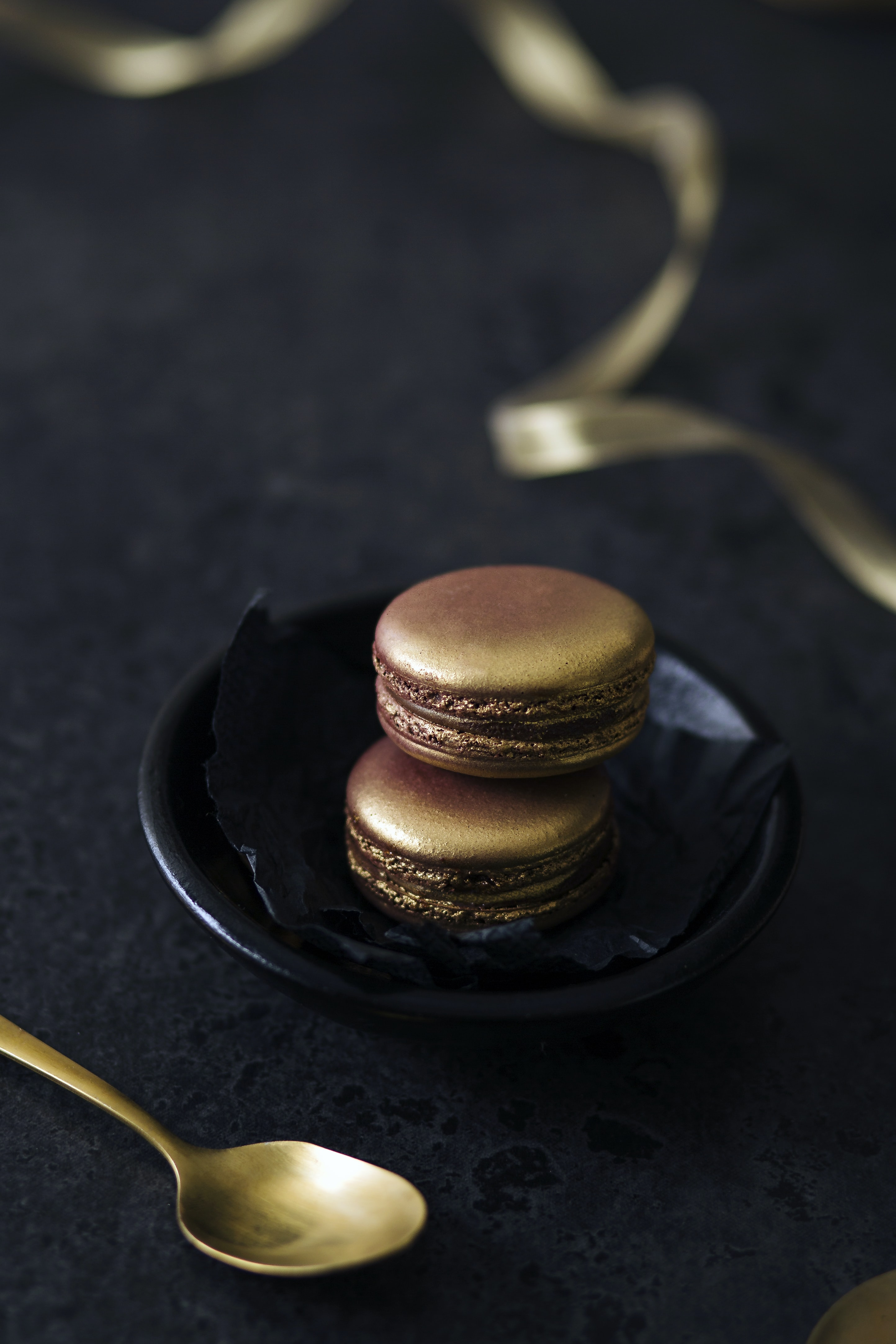 shallow focus photography of brown macarons