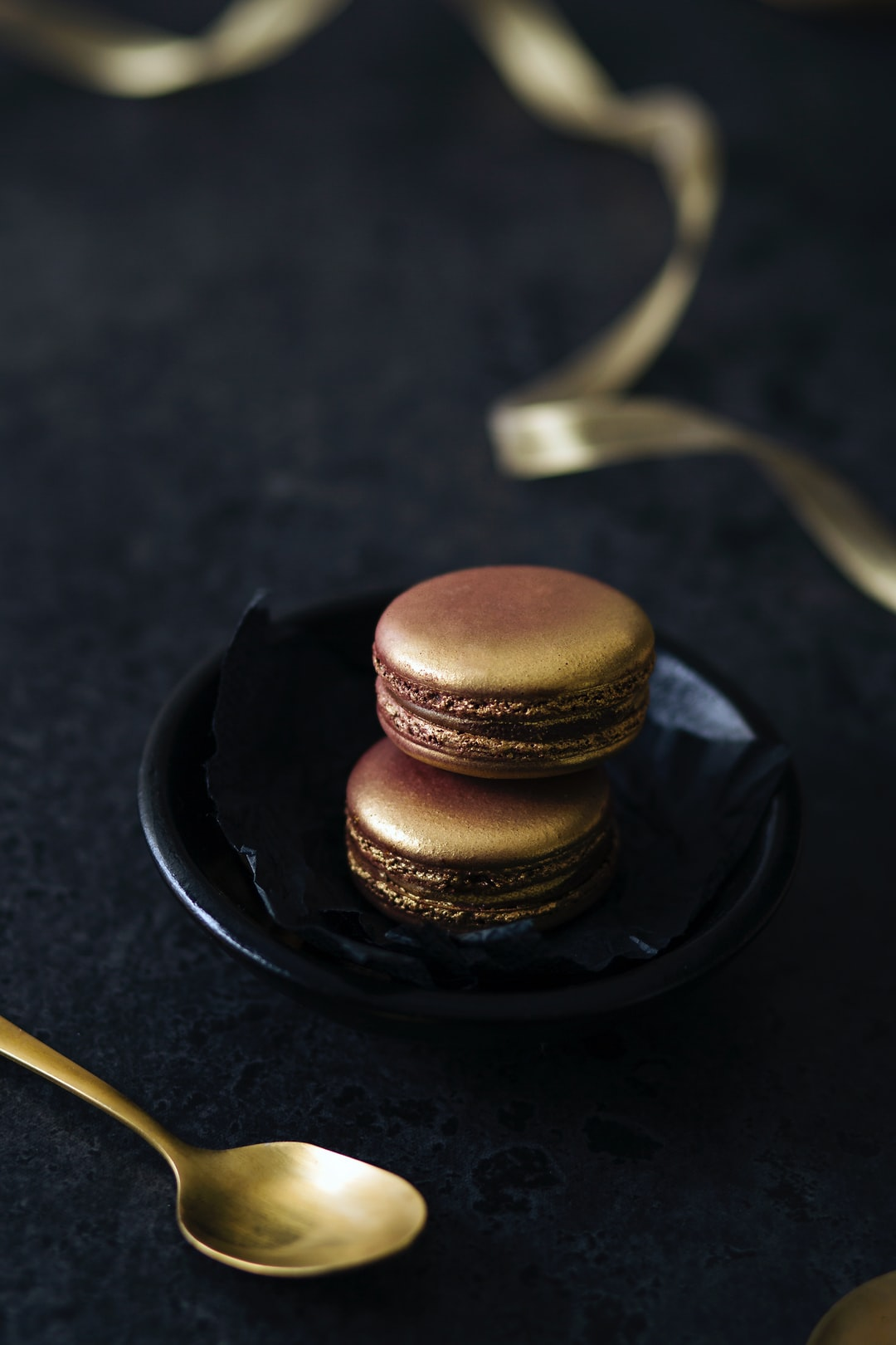 I stumbled upon these gold macarons and had to photograph them. Glam food at its finest! Also playing with monochromatic colours.