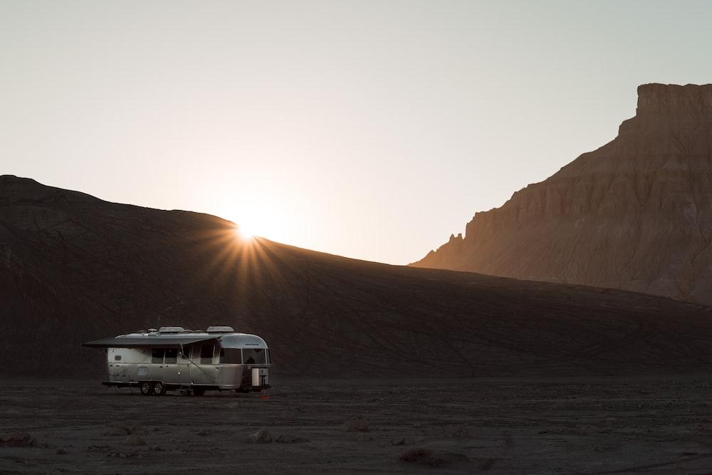 gray camper trailer during golden hour