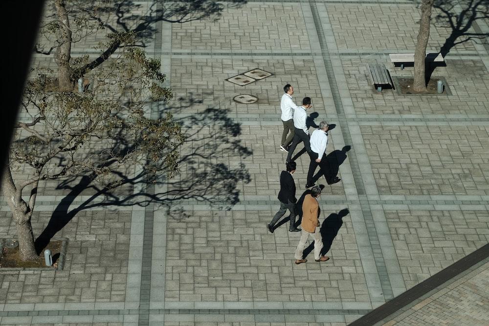 group of men walking at park