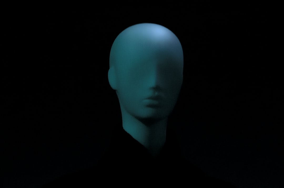 Blue model, mannequin's head, face with no eyes
