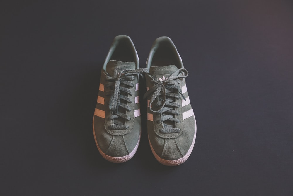 pair of gray adidas shoes
