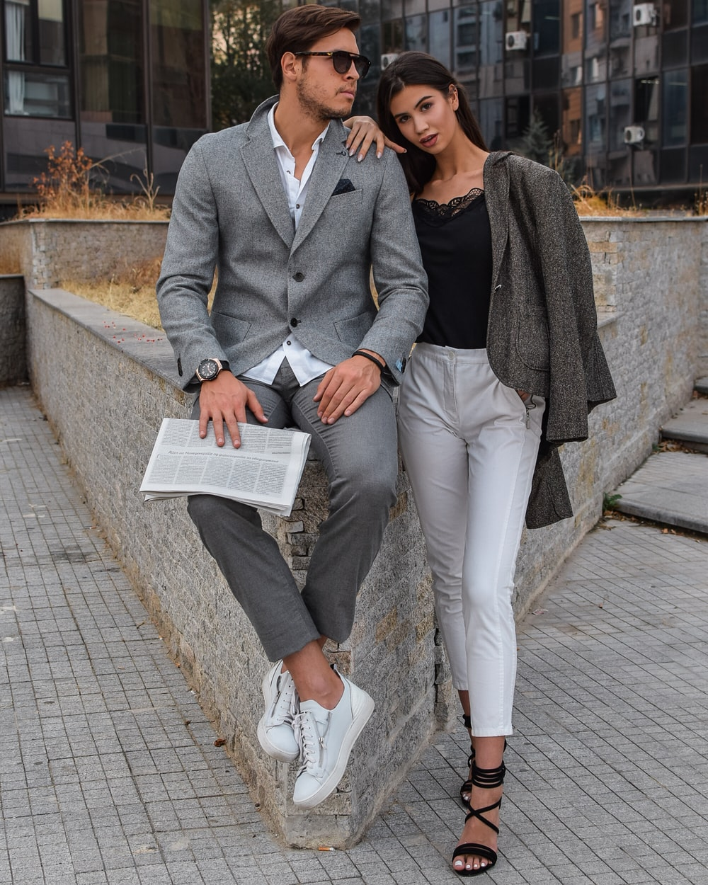 man and woman standing near wall