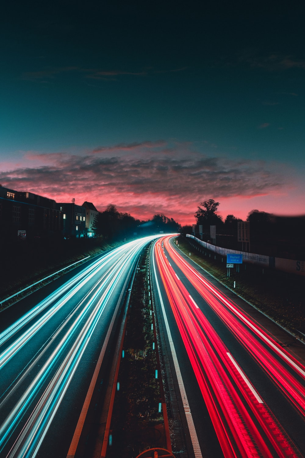 timelapse photography of vehicles at night