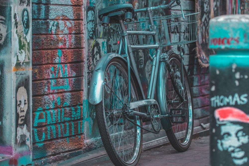 gray bike leaned on wall