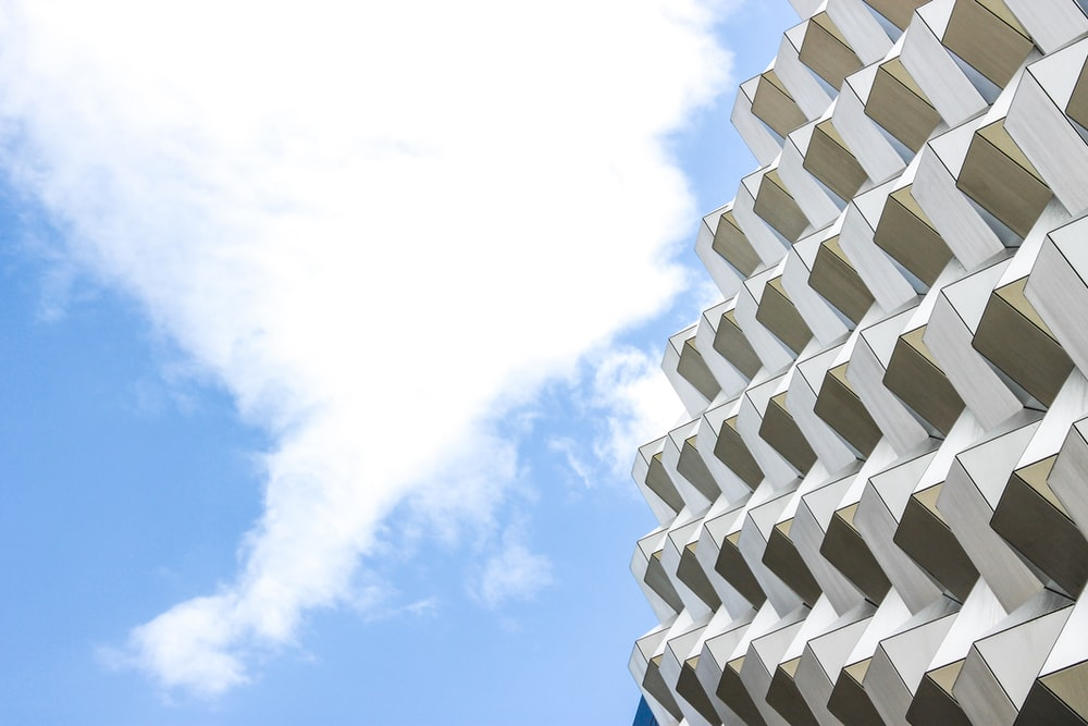 white cloud and white and beige building