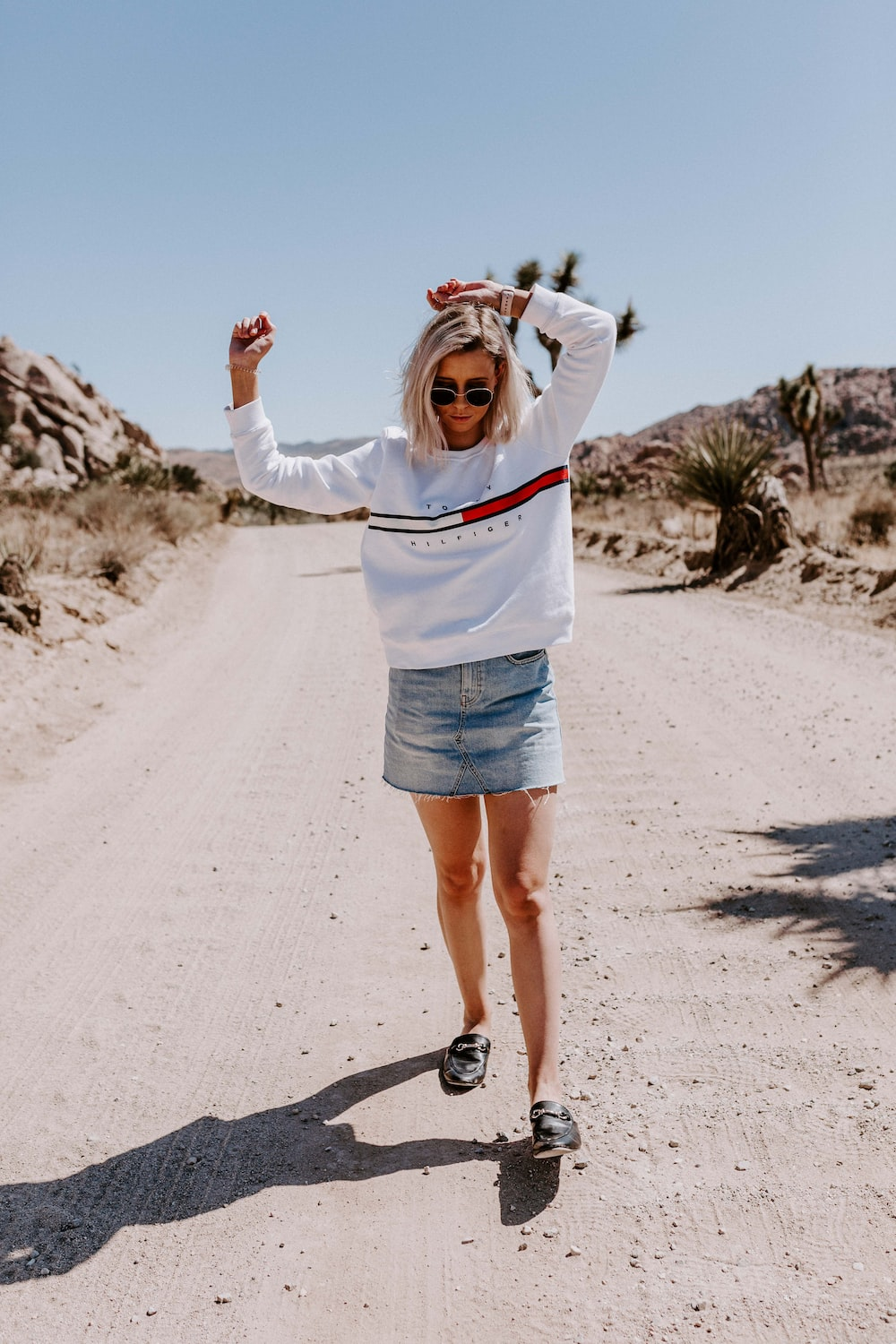 woman wearing white Tommy Hilfiger long-sleeved shirt