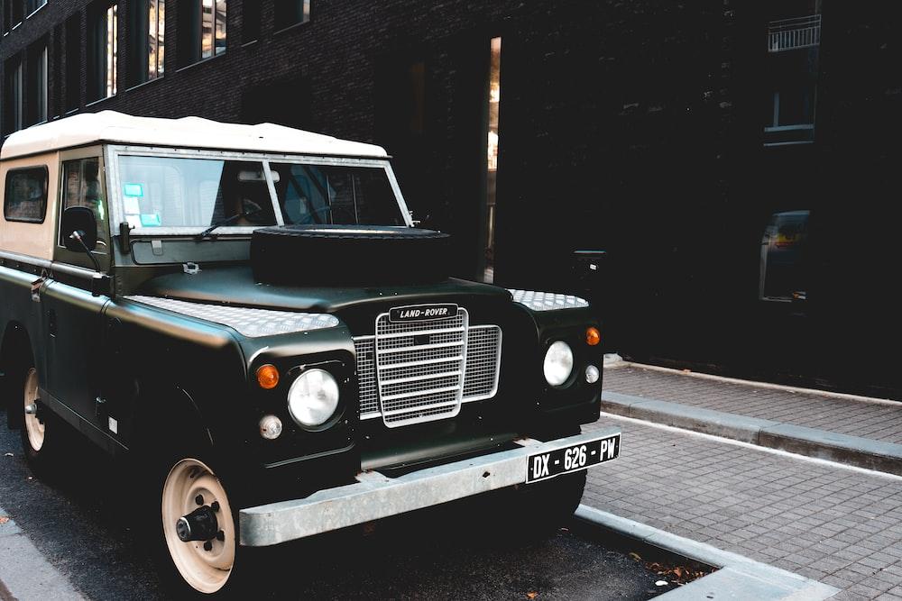 classic black vehicle near on wall