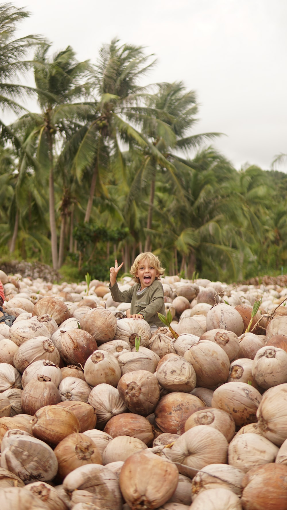 girl sitting on coconut shell