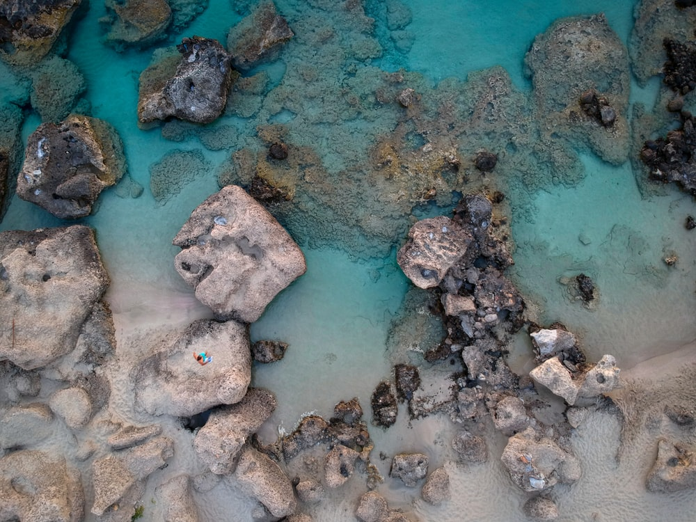 aerial photography of rocks on shore during daytime