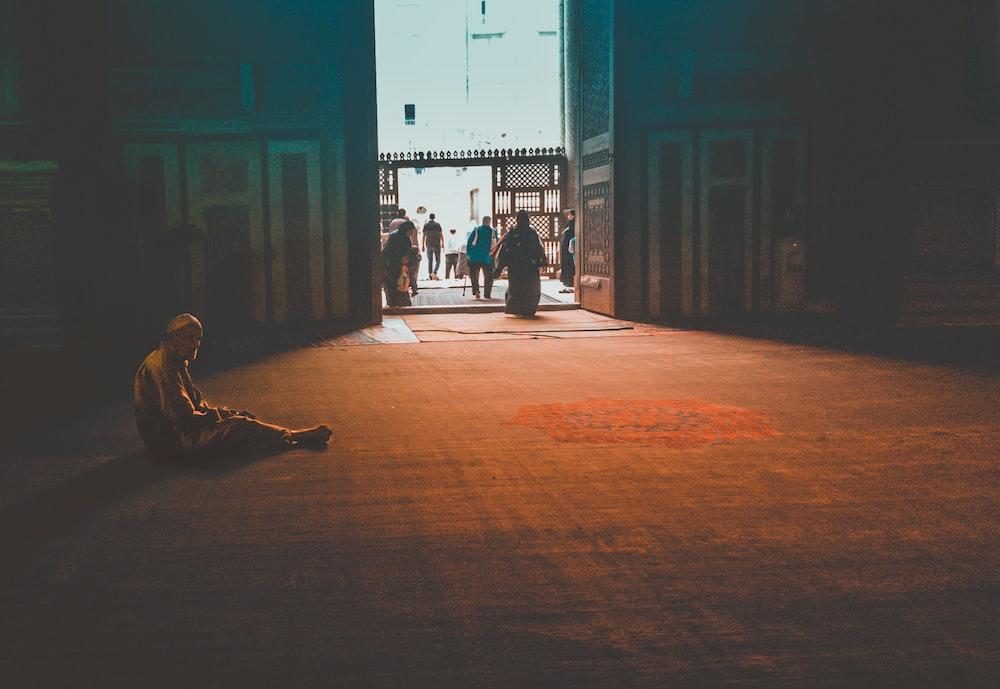 man sitting inside temple during daytime