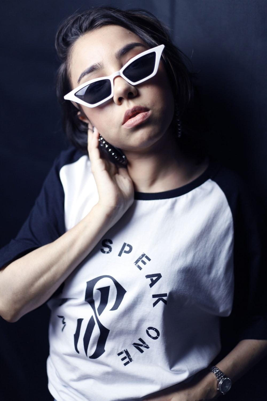 woman wearing white framed sunglasses