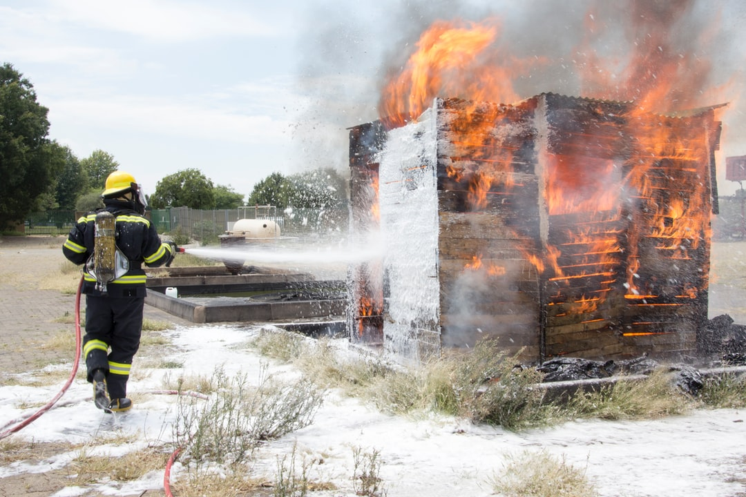 A fireman putting out a controlled burning shack