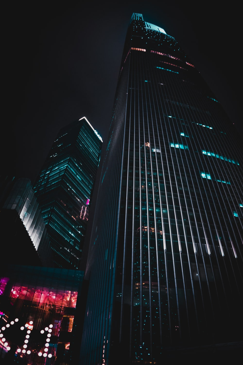 low-angle photography of black high-rise building