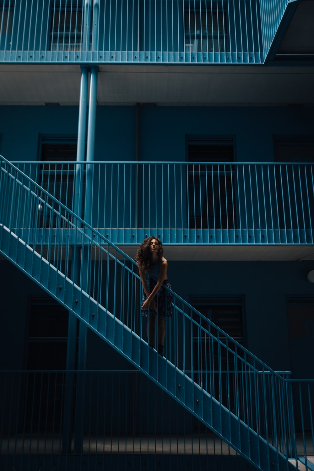 woman standing on stairs during daytime