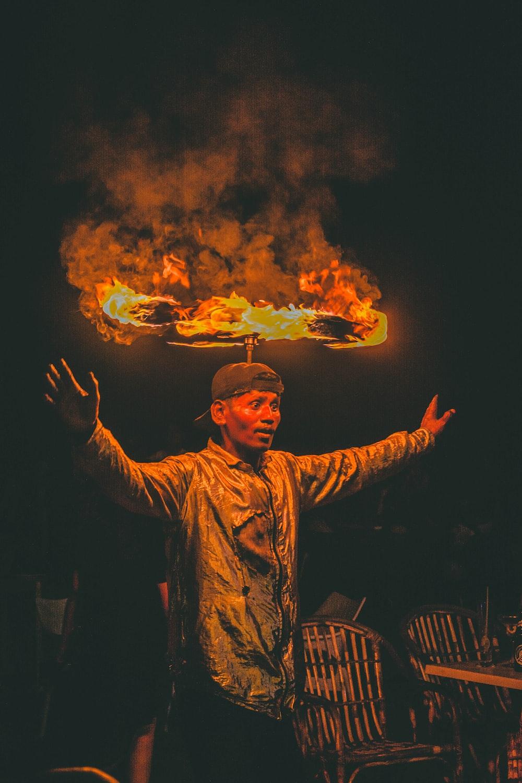 man balancing fire on head